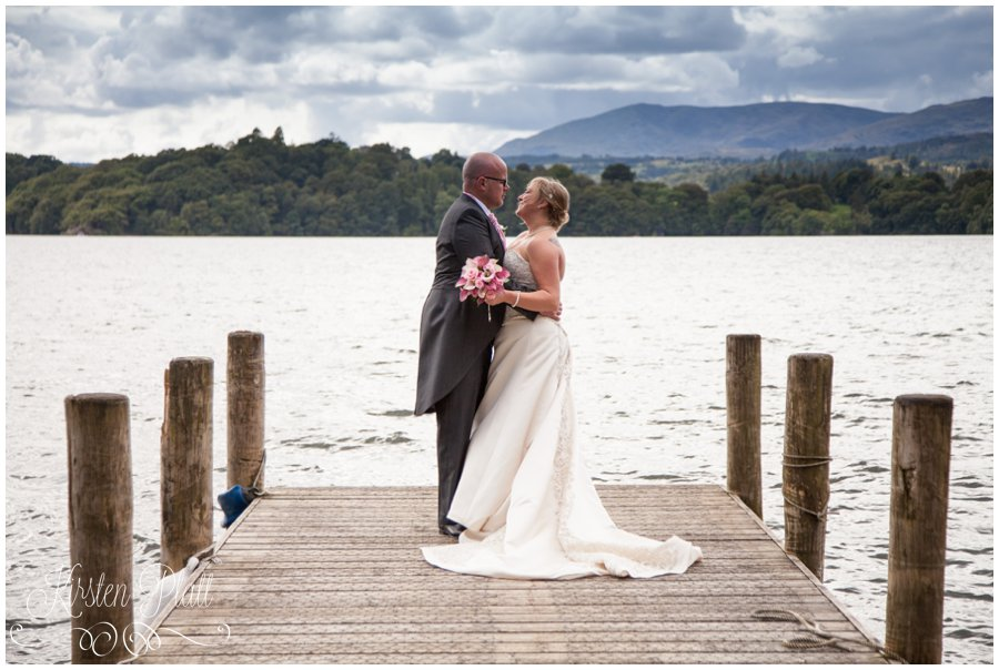 Bride and Groom on the pier at langdale chase windermere