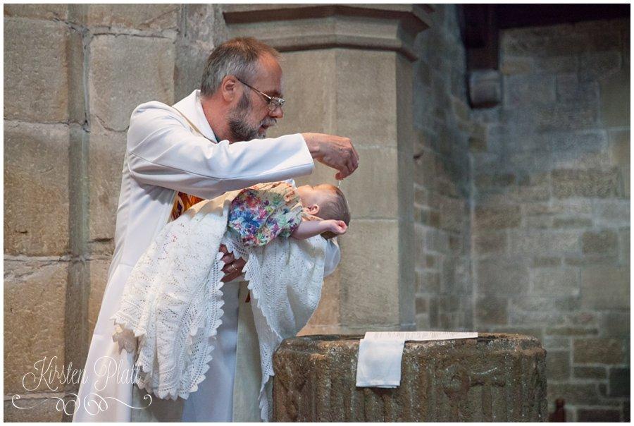 Baby Poppy being christened St Helens Church waddington