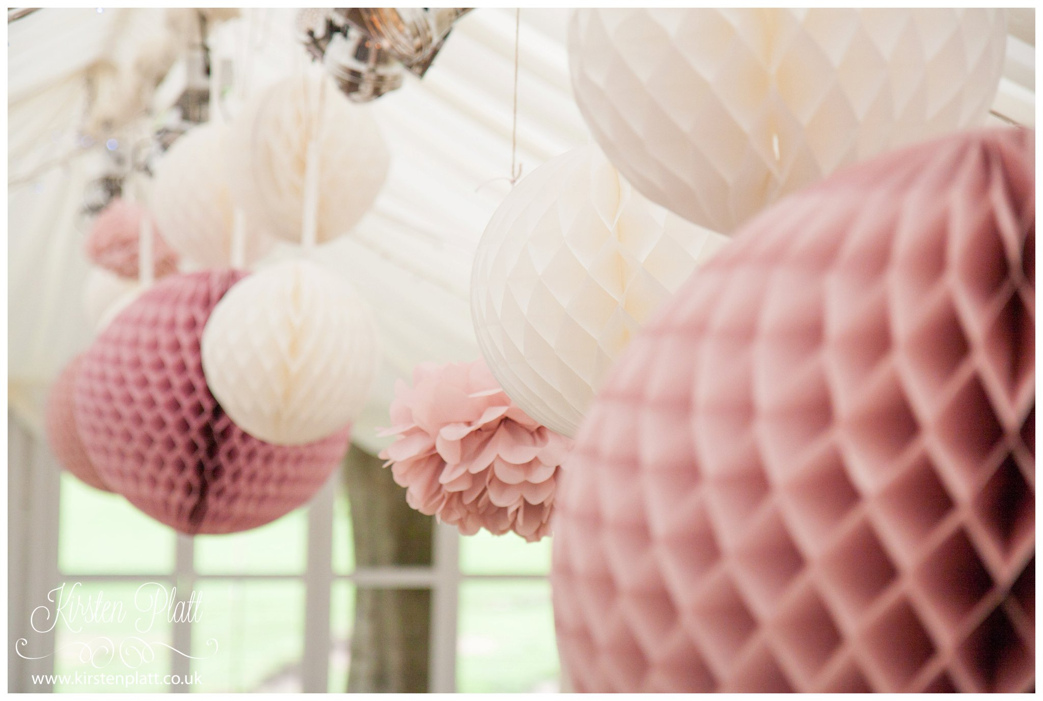 wedding details Pink and cream hanging pompoms wedding decorations at the inn at whitewell