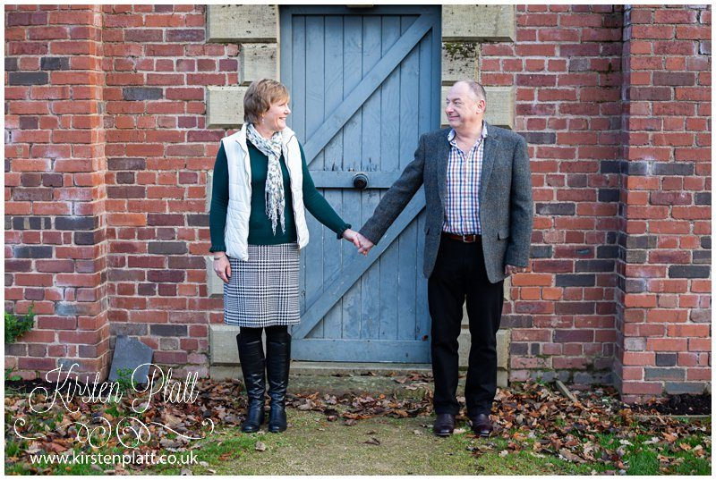 The walled garden at Astley hall couple holding hands