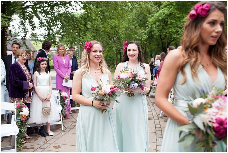 Bridesmaids walk down the isle