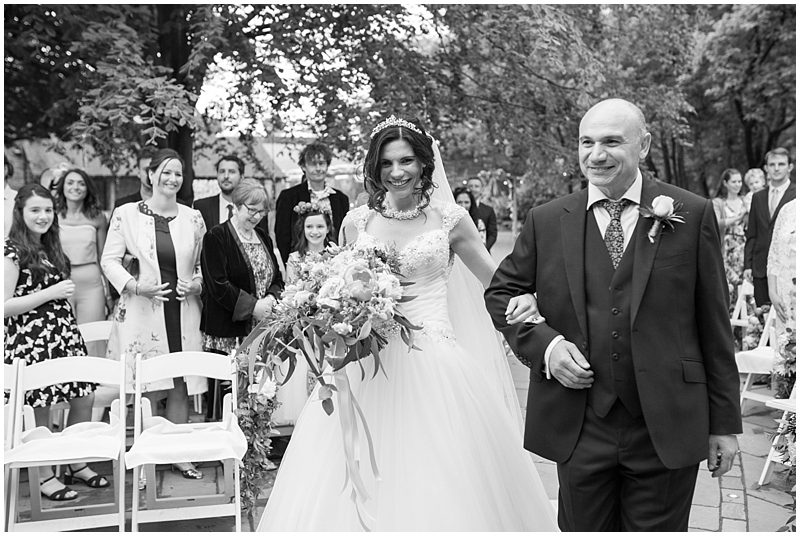 Father walks with the bride down the isle