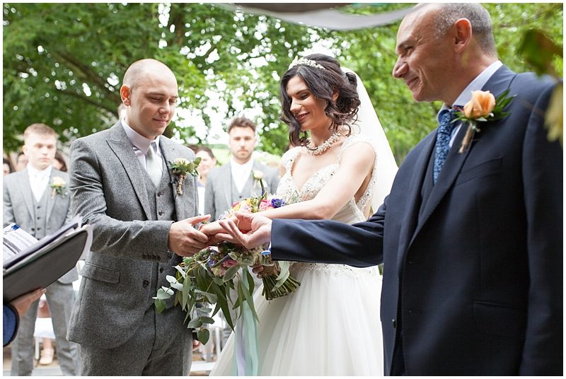 Father giving the bride to the groom