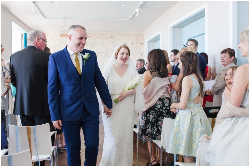 Bride and Groom walk down the isle as Mr and Mrs