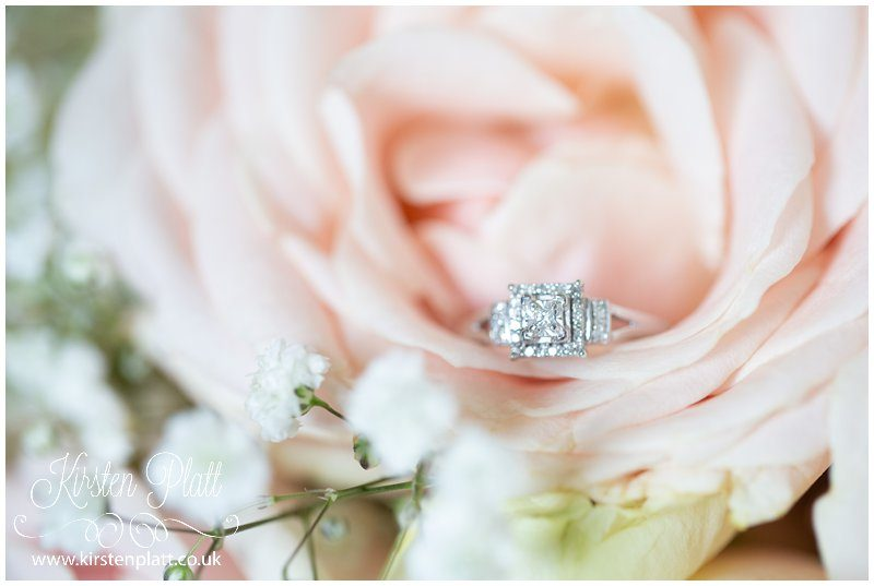 Engagement ring and pink roses