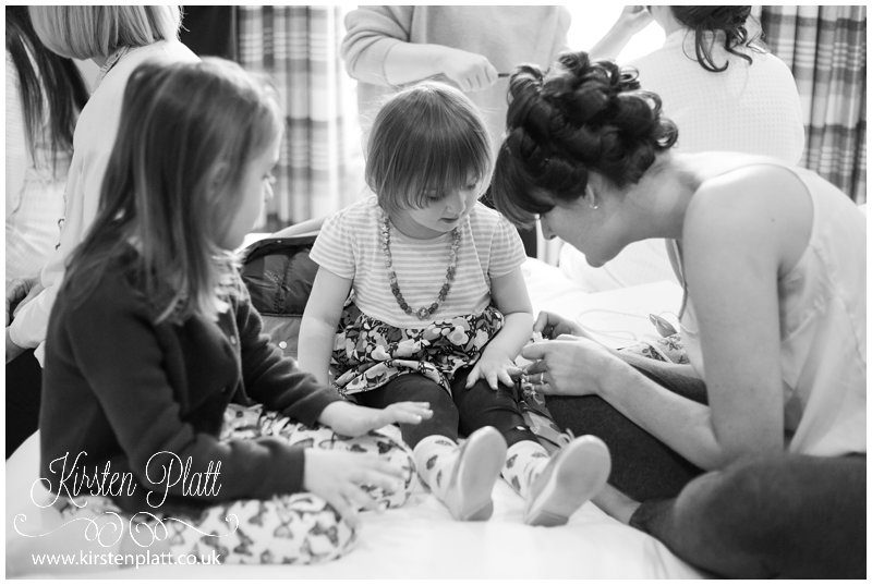 The bride painting the flower girls nails