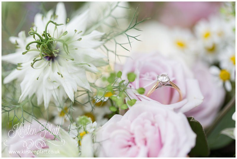 Brides solitaire ring and pink roses
