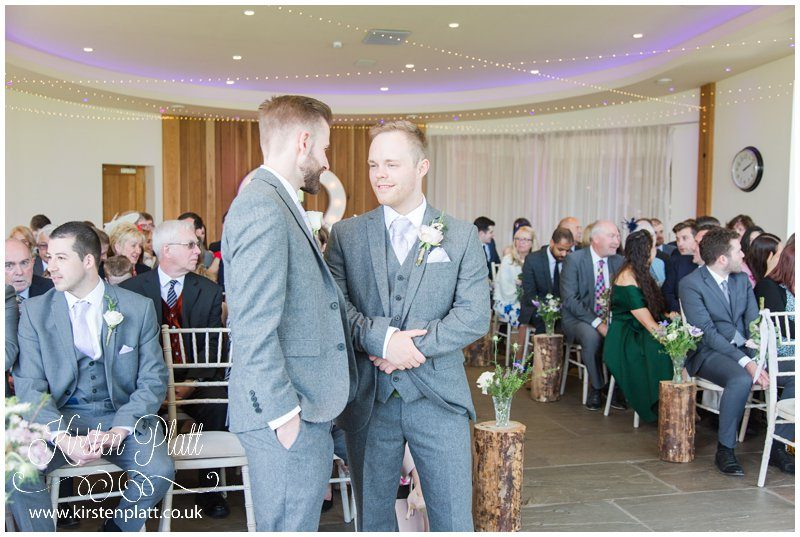 The Groom and Bestman waiting at the top to the isle