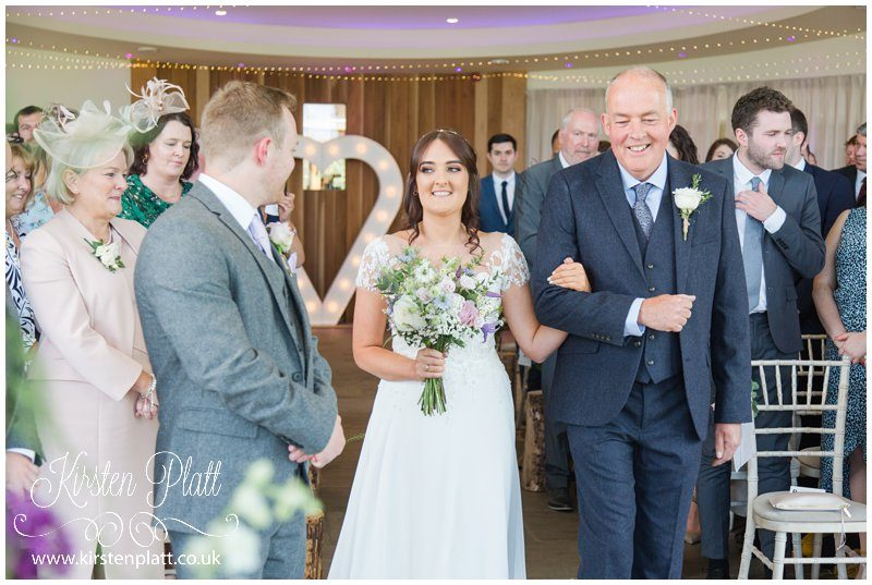 The bride and grooms eyes meet for the first time