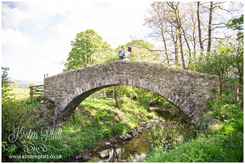 Bride and Groom on The fairy Bridge at The out Barn Clough Bottom