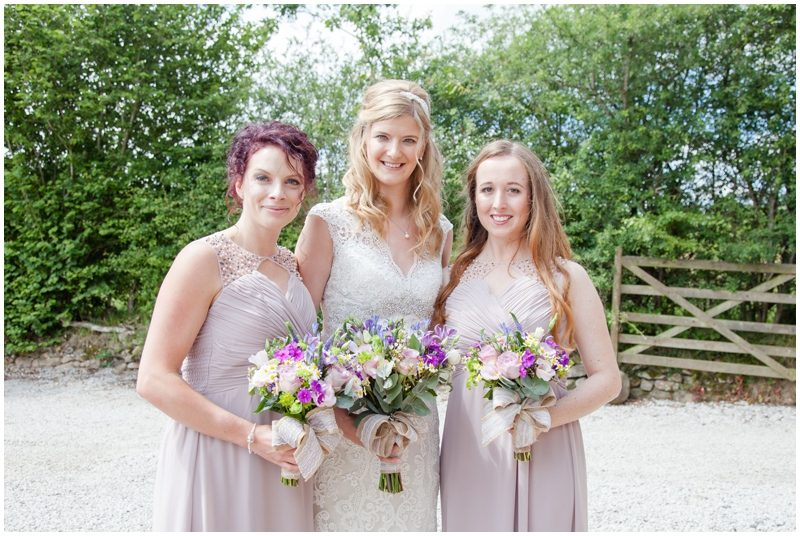 Bride and Bridesmaids with their flowers