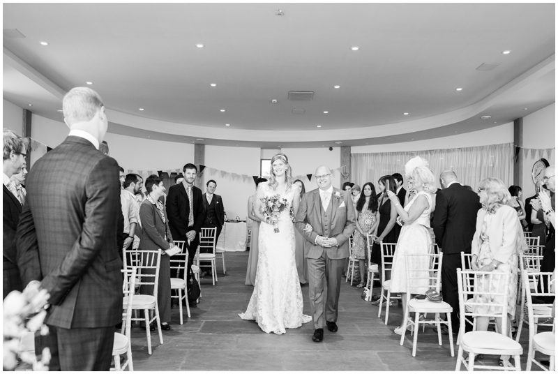 The bride walks down the isle with her father