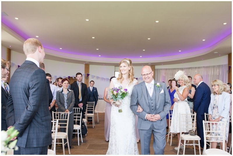 The bride and grooms eyes meet as she walks down the isle