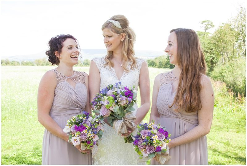 Bride chatting with her bridesmaids