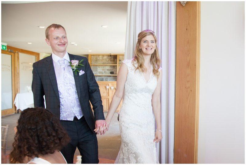 Bride and groom enter the wedding breakfast room