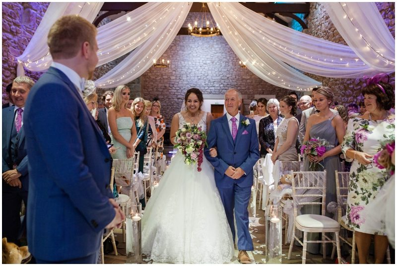 Bride walks down the isle with father